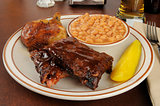 Barbecued chicken and ribs