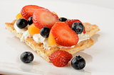 Fruit and cream cheese on sesame flatbread