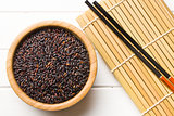 black rice in wooden bowl