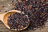 black rice with wooden spoon