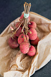 A bunch of Lychees on a paper bag