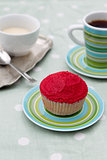 Red cupcake with coffee and cream