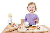 happy child making pizza