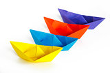 Four colored paper ship on a white background