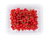 pile berries of red currant on white background