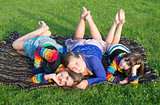 Girls have a rest on a grass.