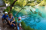 Family near summer azure  limpid  transparent lake (Plitvice, Cr