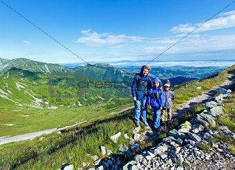 Family in summer Tatra Mountain, Poland