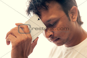 indian man holding a smartphone