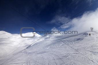 Skier on start of ski slope