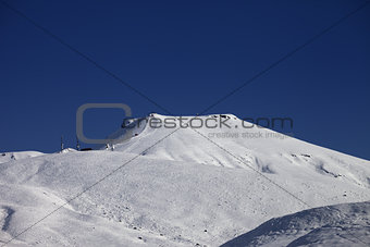 Off-piste slope with traces of skis at nice sunny day