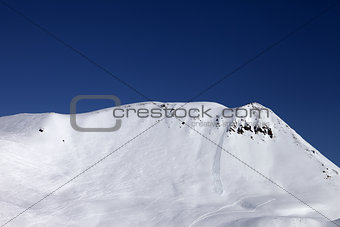 Off-piste slope with trace of skis, snowboarding and avalanche