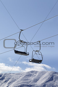 Chair lifts and off piste slope at nice day