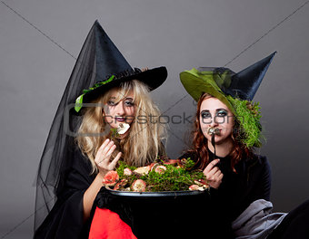 Halloween party - women in costumes of witches