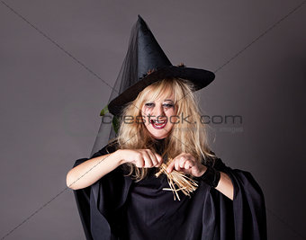 witch casts a spell on a straw doll