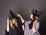 Two women treated costumes of witches