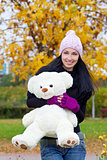 happy young woman with a teddy bear