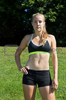 Athletic woman in a sports bra and shorts