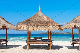 Three beach house on the sandy coast of blue sea