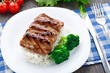 Grilled ribs with rice and broccoli