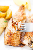 Fried mackerel on a fork