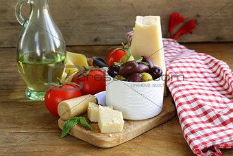 olives, parmesan cheese, tomatoes and basil