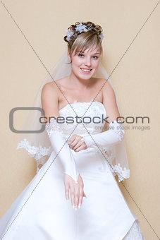 bride puts on a glove