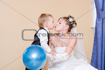 A bride kisses her little brother