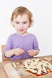 cute girl making fresh pizza