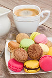 plate of  macaroons  with coffee