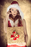 sensual christmas female with cute present