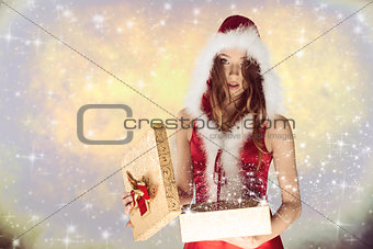 cute xmas girl opening her gift
