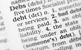 Macro image of dictionary definition of debt
