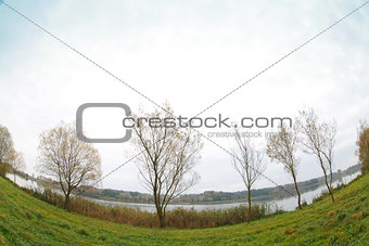 Autumn landscape with water and trees on the coast