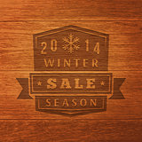 2014 Winter Sale Label On Wood Texture. Vector Background