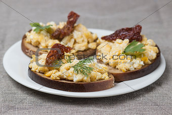 a classic, simple breakfast: scrambled eggs on toast