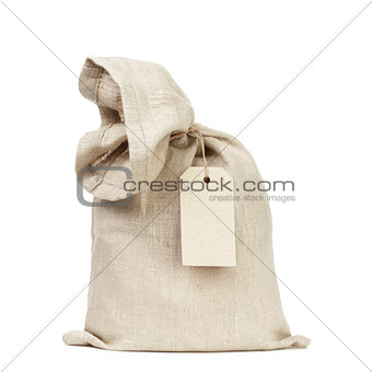tied sack bag with paper tag