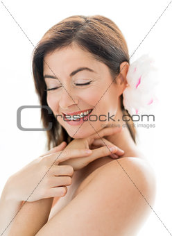attractive woman in her forties with a flower in her hair