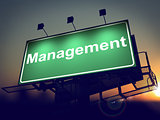Management - Billboard on the Sunrise Background.