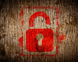 Red  Icon of Opened Padlock on Wood.