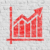 Red Growth Chart Icon on White Brick Wall.