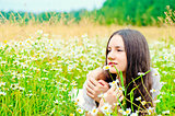 girl resting in a field of chamomile