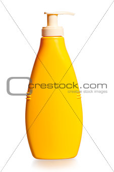 cosmetic bottle in yellow on a white background