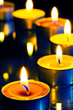 A group of small candles on a dark background