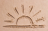 the sun sets over the horizon at sea drawing in the sand