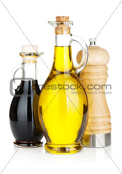 Olive oil and vinegar bottles with pepper shaker