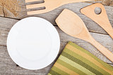 Empty plate and utensils on wood table