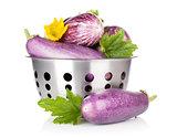 Fresh ripe eggplants in colander