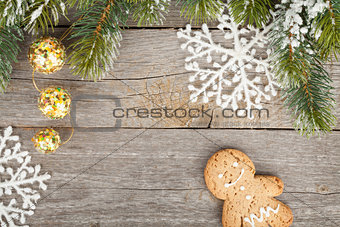 Christmas fir tree and decor on wooden board background