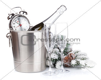 Champagne bottle in bucket, glasses and alarm clock